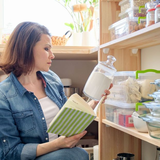 bigstock Woman In Pantry With Groceries 359144305