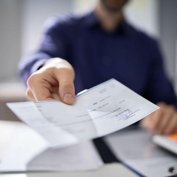 bigstock Businessperson Hands Giving Ch 344136691