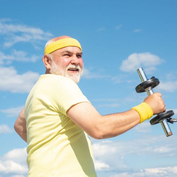 bigstock Old Mature Man Exercising With 327265105