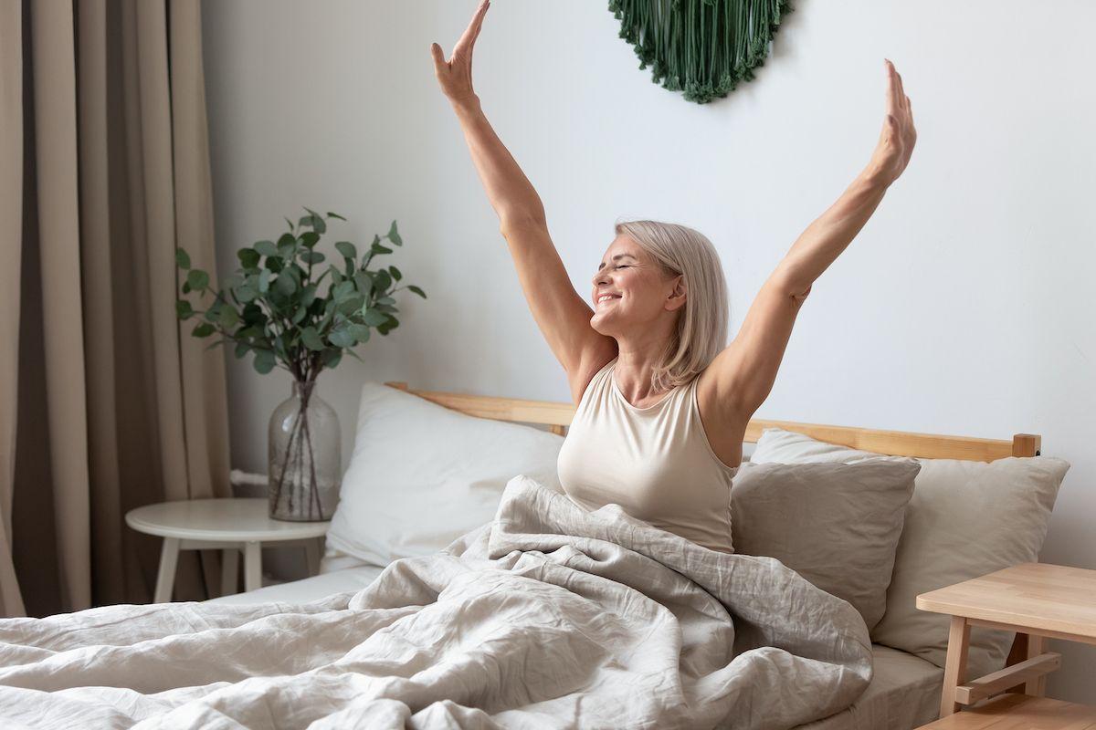 bigstock-happy-mature-woman-stretching-328705408