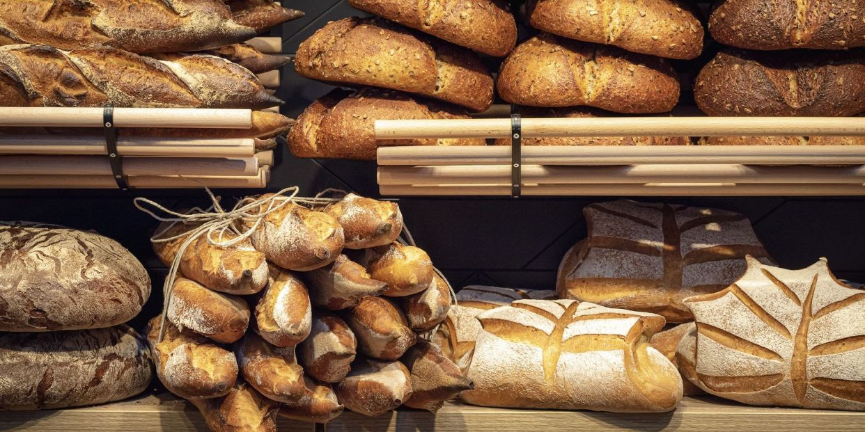 bigstock Loaves Of Bread On Wooden Shel 349193068