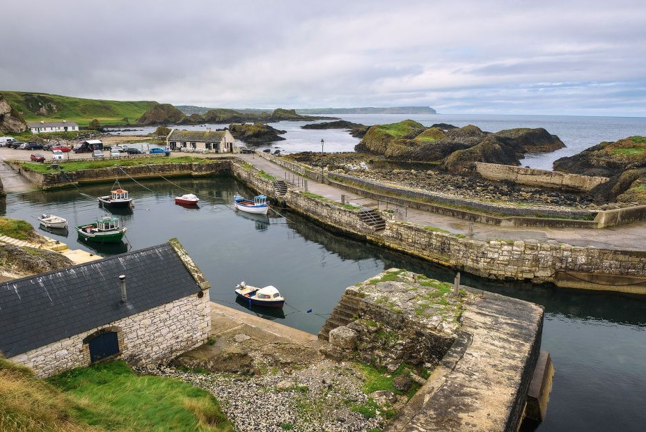 bigstock Ballintoy Harbor With Boats An 280636996