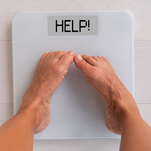 bigstock HELP weight scale showing the  312634546