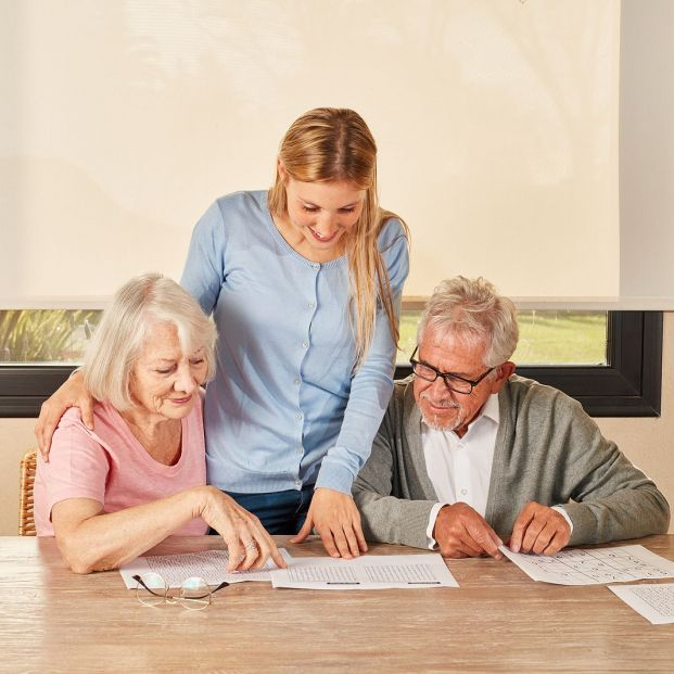 bigstock Daughter helps senior couple w 340578496