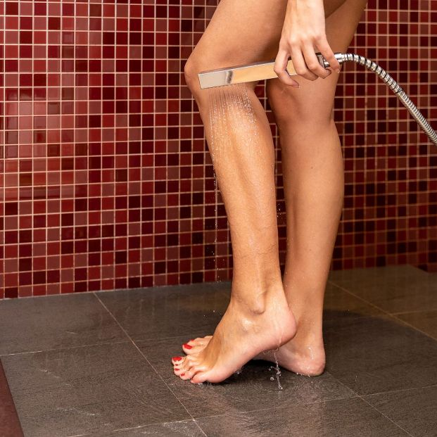 bigstock A Woman s Legs In The Shower  359756521