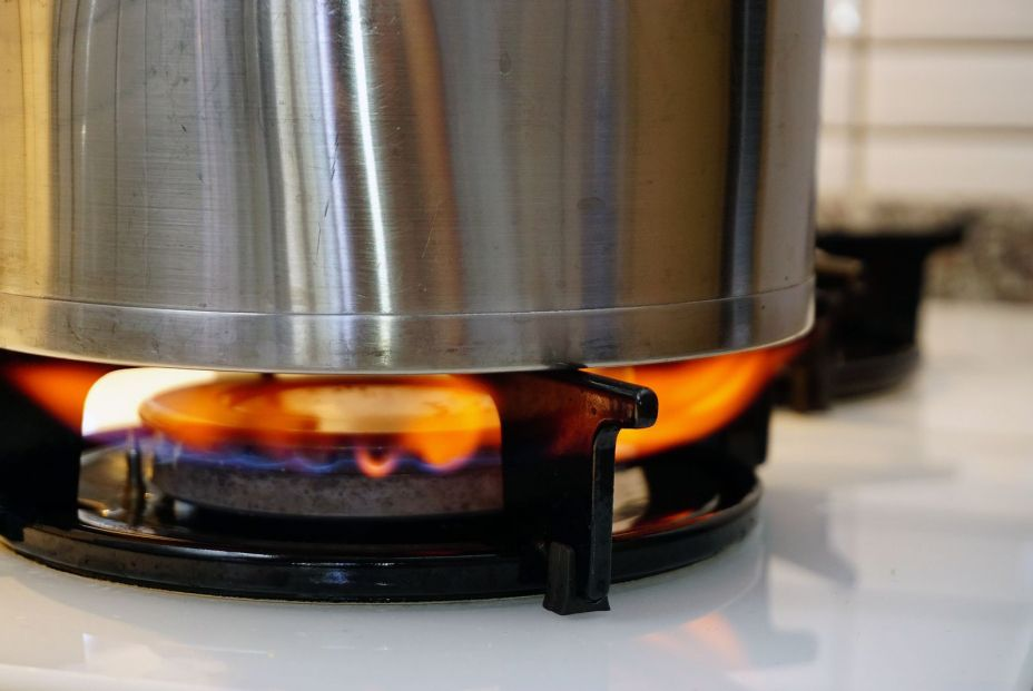 bigstock Oven Fire With Frypan Close Up 323257330
