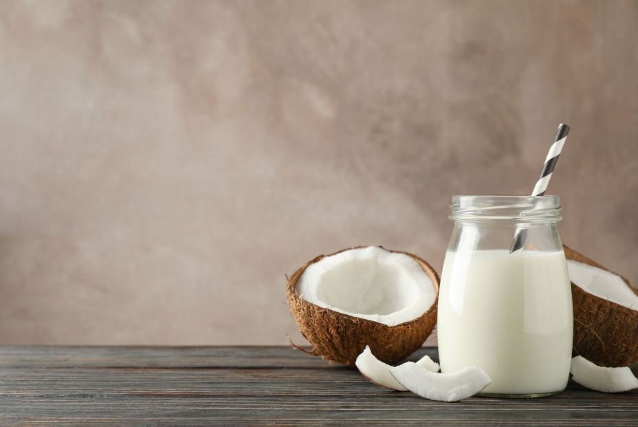 bigstock Bottle Of Coconut Milk With St 337521388