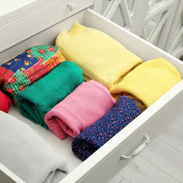 bigstock Folded Clothes In Open Drawer  362057533