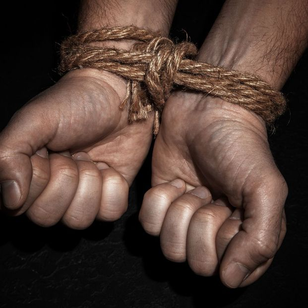 bigstock Man With Hands Tied With Rope  272183233
