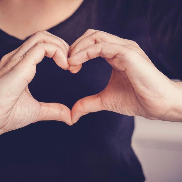 bigstock Woman Making Hands In Heart Sh 378221860