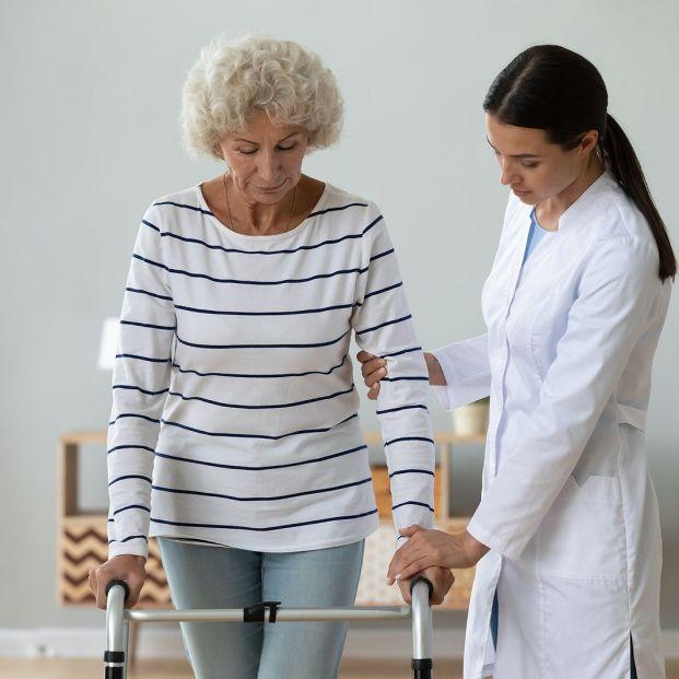 bigstock Medical Worker Helping Older M 381002072