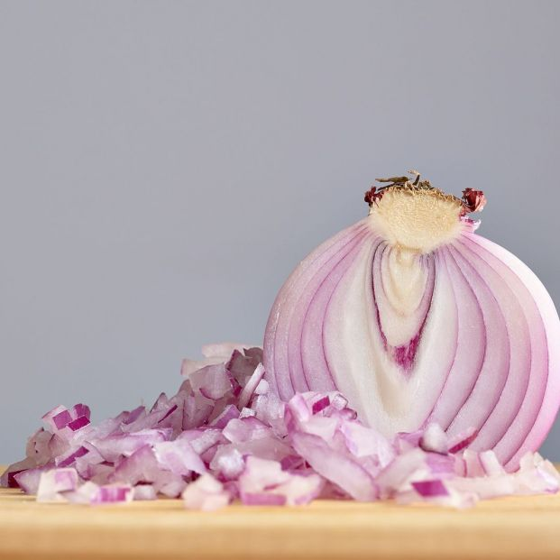 bigstock Half A Raw Red Onion With A Pi 374745448