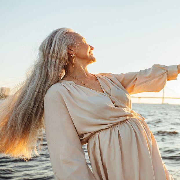bigstock Elderly Woman With Long Hair H 385655939