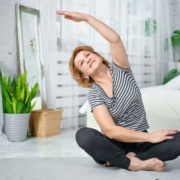 bigstock Senior Woman Exercising While  354761096