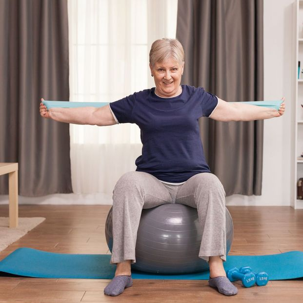 bigstock Senior Woman Working Out At Ho 387684676