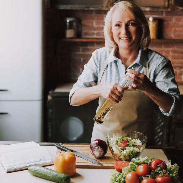 bigstock Senior Woman Cooking Salad In  256985776