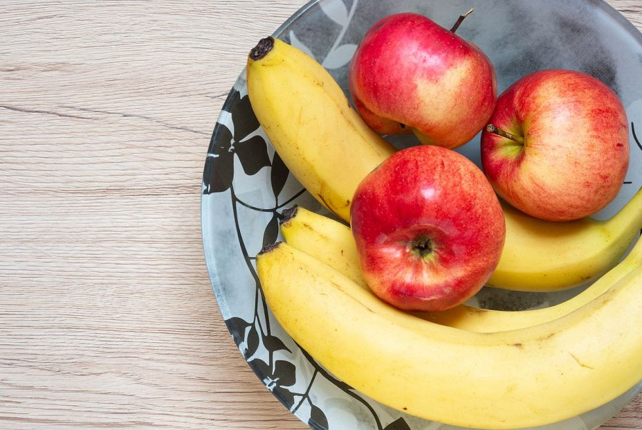 bigstock Bananas And Red Apples On Bow  390148129