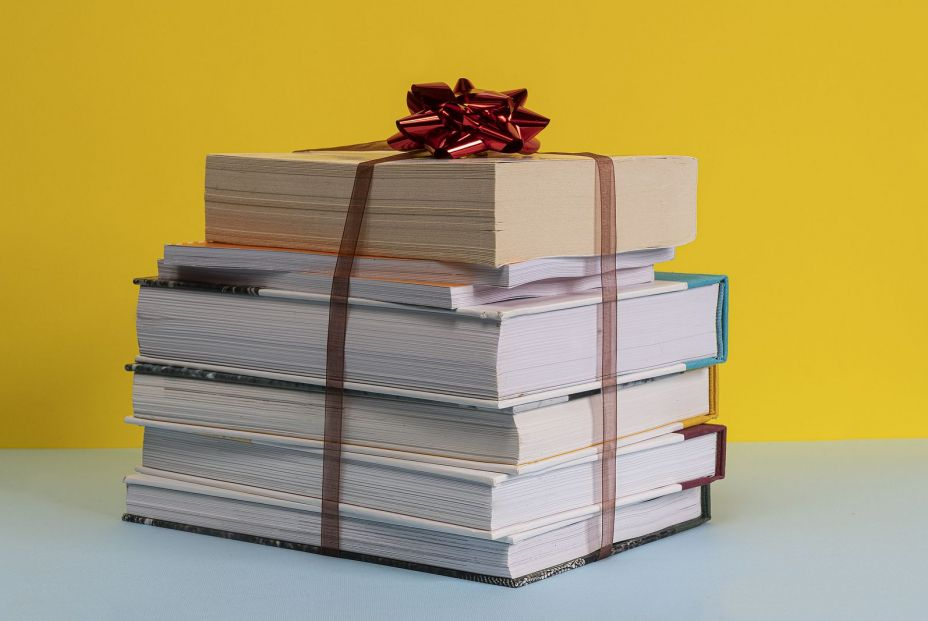 bigstock The Gift Of A Pile Of Books Bo 325598902