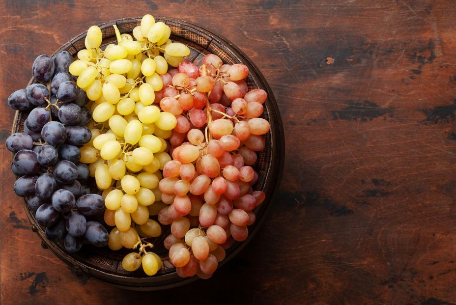 bigstock Various grapes on old wooden b 398333861