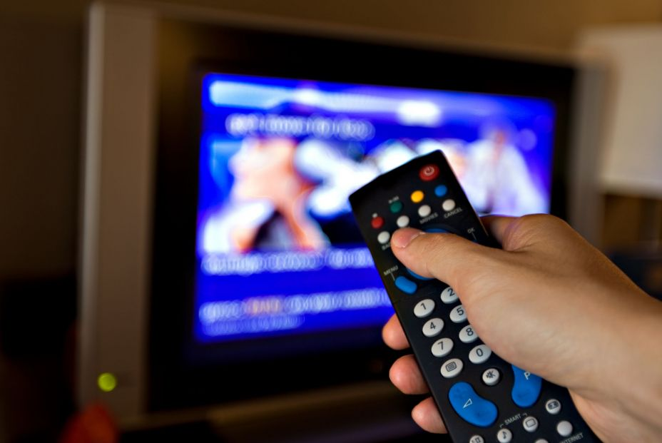 bigstock Hand pointing a tv remote cont 18496238