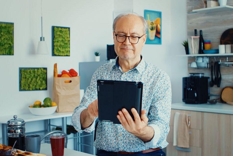 bigstock Happy Older Man In Kitchen Dur 392873684