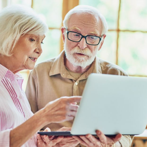 bigstock Elderly Couple Using Computer  414814565