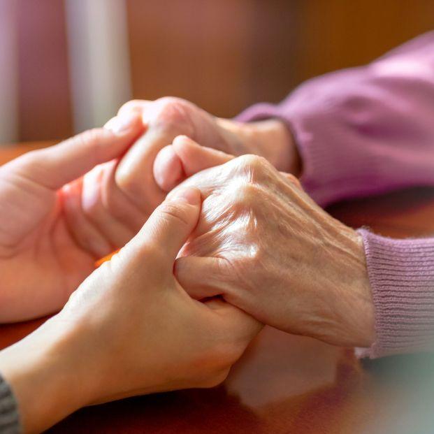 bigstock Elderly Hands Helping Hands O 365834185