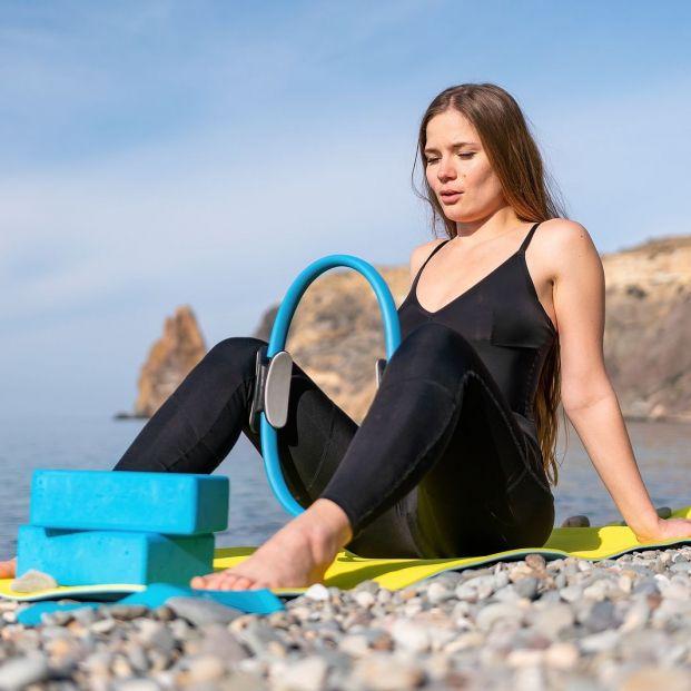 Agrégale potencia a tu rutina de ejercicios usando un aro de pilates Foto: bigstock
