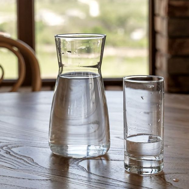 bigstock Water In Jug And Glass On Wood 425557202