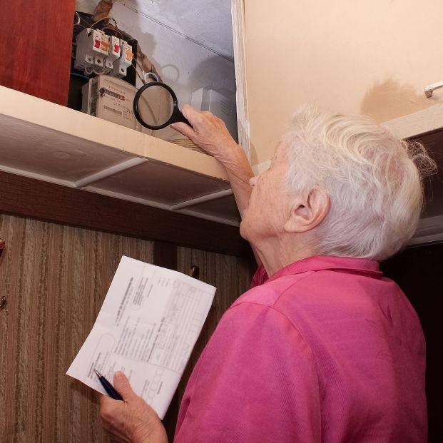 bigstock Terrified Woman Is Checking El 431302238