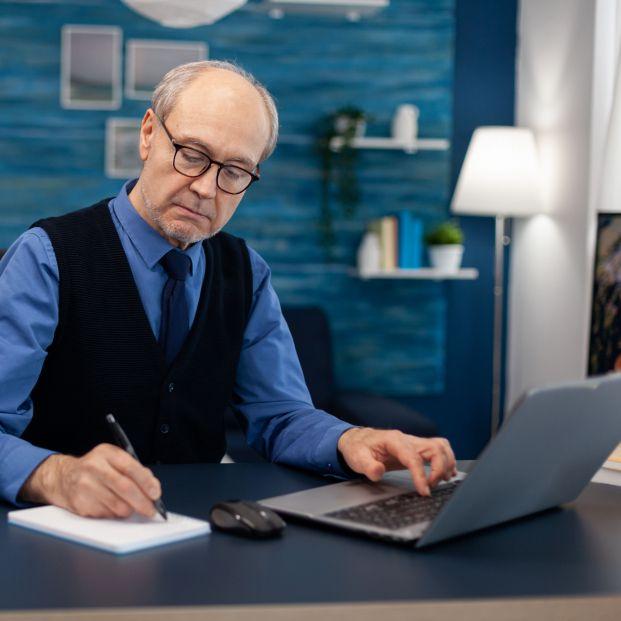 bigstock Senior Businessman Writing Not 411795052