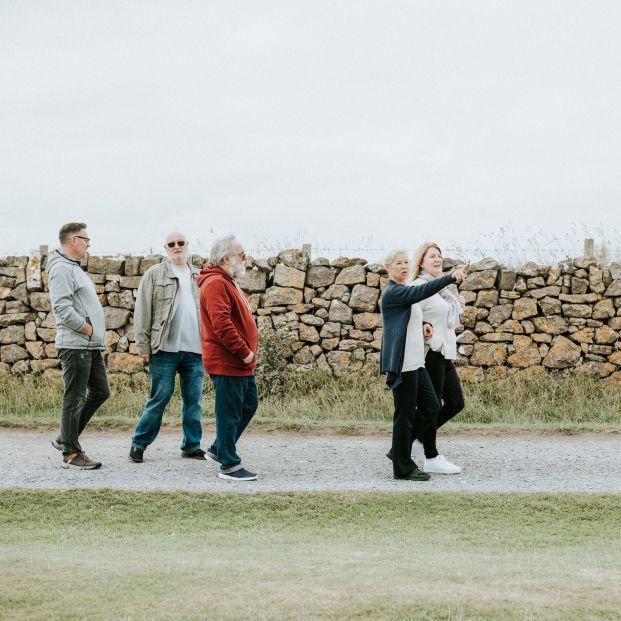 bigstock Group of elderly people stroll 434315852